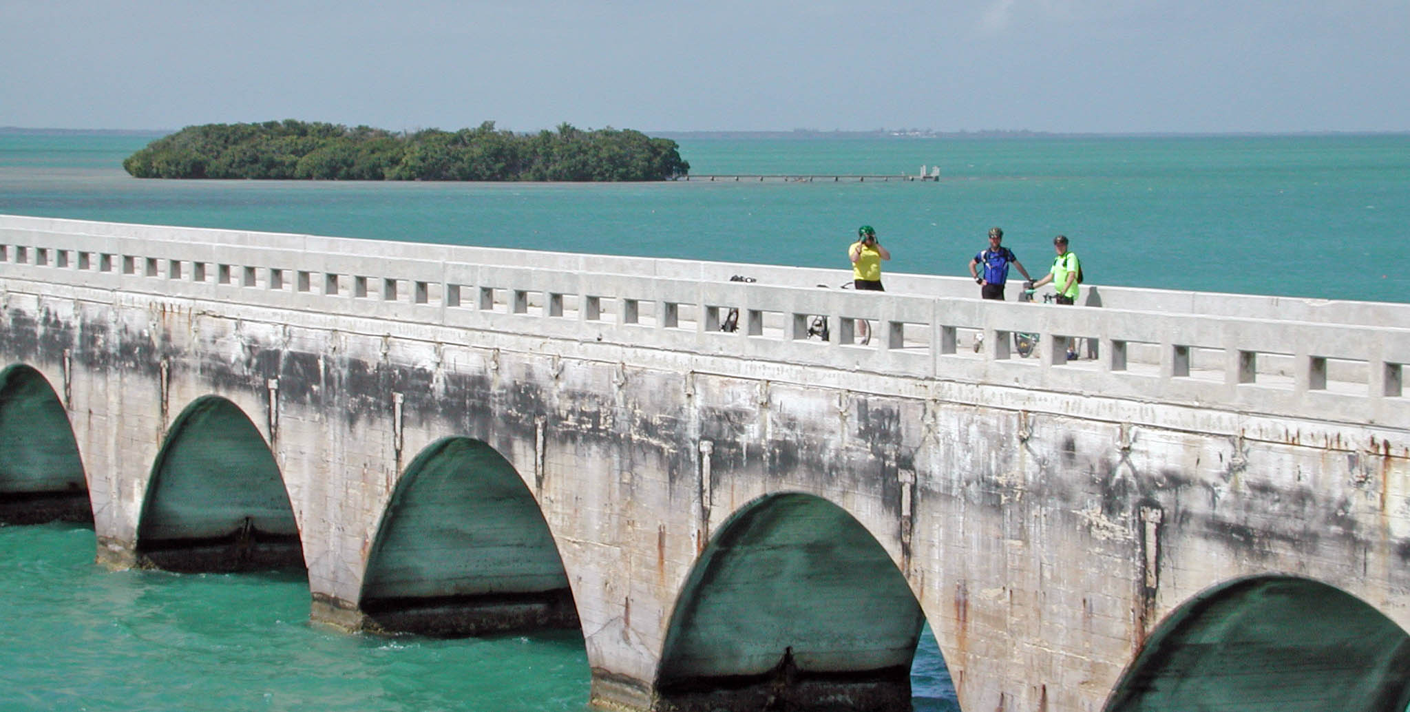 Matt, Wally and Mark with their bikes on a Bridge on the way to Key West, Florida