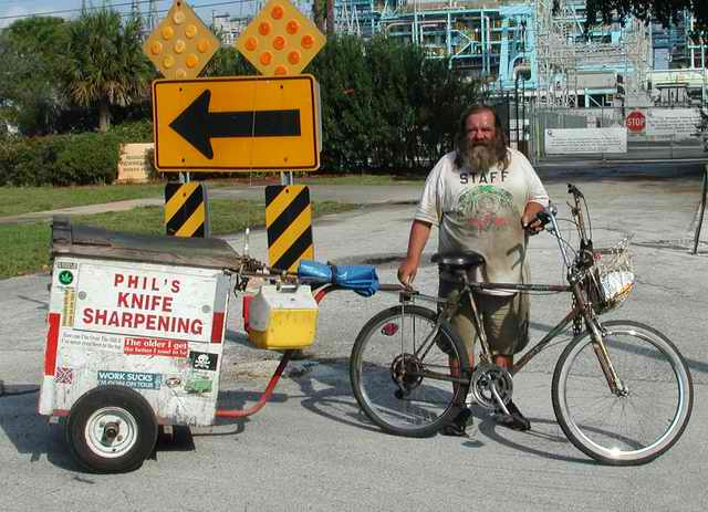 Phil poses with his bike and homemade trailer.