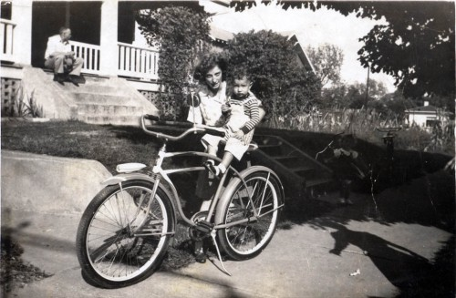 Lucille Hoffman Perry holds Jerry Hoffman, her nephew on bike