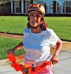 Pat Atwater with her orange hula lei