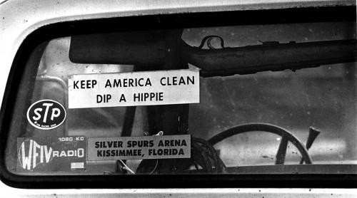 Dip a Hippy bumper sticker under pickup rifle rack