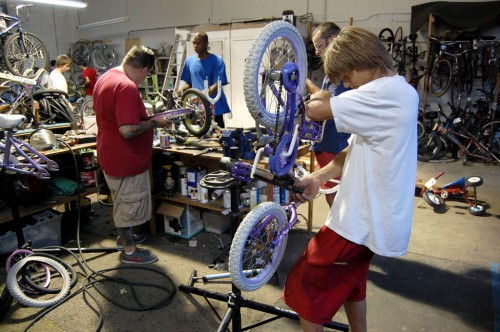 The West Palm Beach Freakbike Militia fixing bikes for Jack the Bike Man