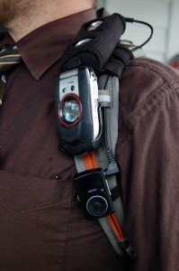 SanDisk Sansa Clip on CamelBak below cell phone and i-Ride Pro speaker
