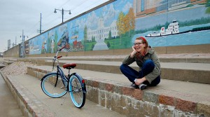 Amy Murphy on Mississippi River bank in Cape Girardeau, MO, with her Tahiti bike