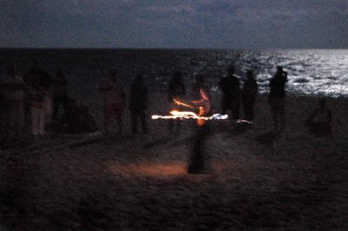 Fire dancer on Lake Worth (FL) Beach during Full Moon Drum Circle