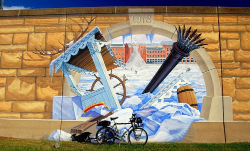 Surly Long Haul Trucker in front of mural showing Mississippi River clogged with ice in 1918