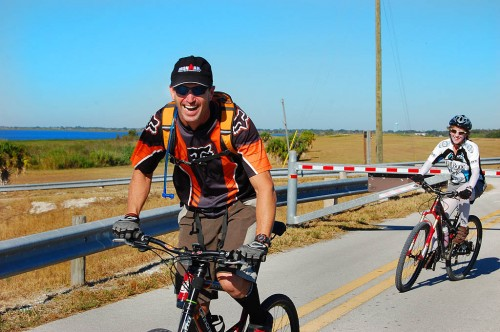 Chris and Lynn dodge gate on Lake Okeechobee Scenic Trail