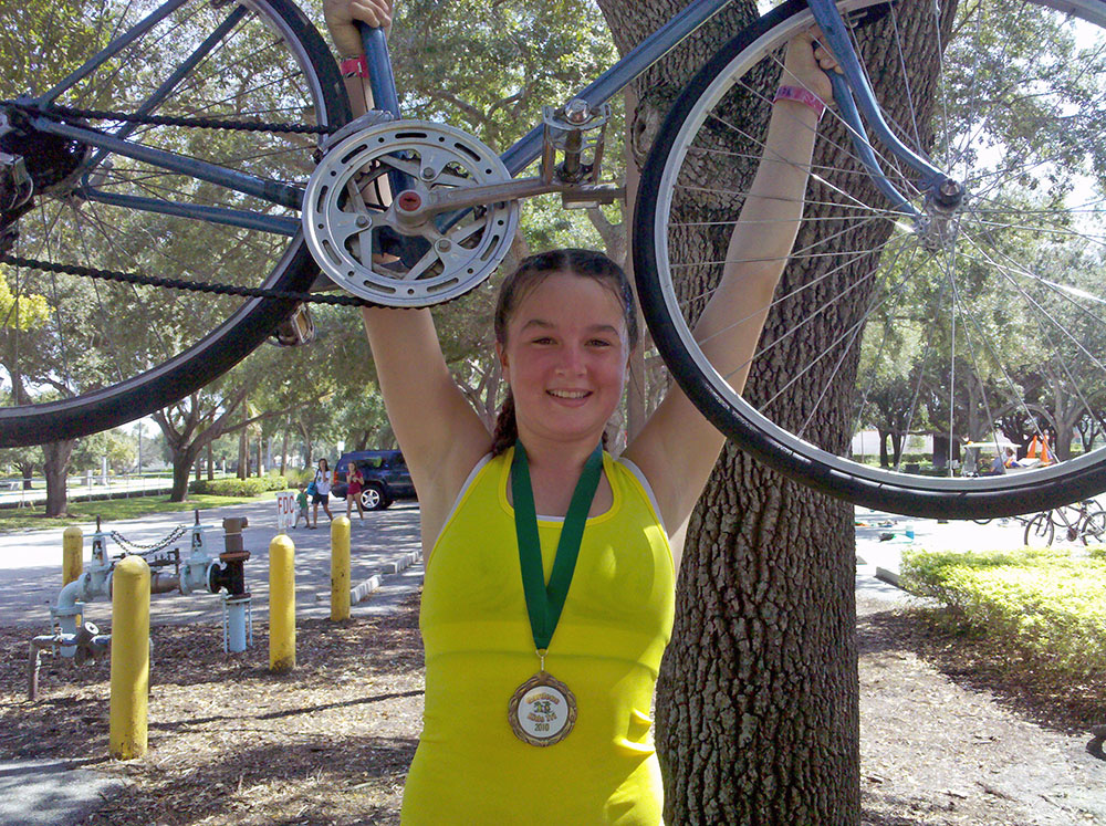 "Valerie, 274, finished the Gardens Kids Tri on ""Old Blue"""